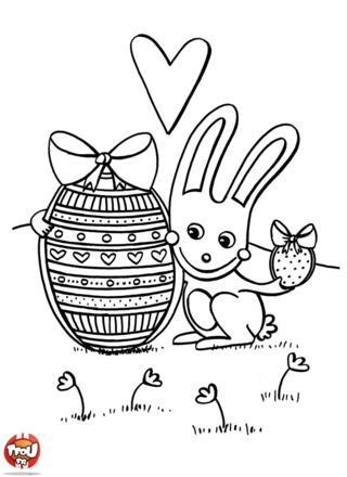 Coloriage : Oooh qu'il est trop craquant ce coloriage à imprimer avec ce petit lapin et ses oeufs de Pâques ! Les gourmands ne vont pas résister à l'envie d'imprimer ce coloriage avec ces beaux oeufs en chocolat. Et regarde bien le coloriage du lapin de Pâques, Il t'a dessiné un joli coeur pour te dire de le rejoindre. Une fois imprimé tu vas pouvoir mettre de jolies couleurs à ce coloriage du lapin de Pâques ! Viens vite imprimer ce coloriage et partage les oeufs en chocolat avec ce gentil lapin.