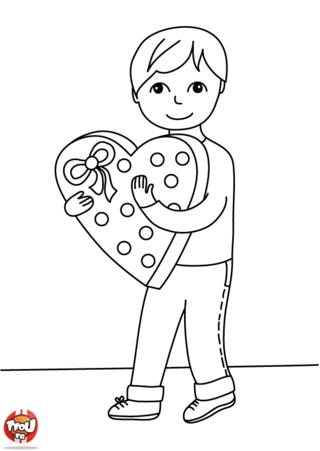 Ce petit garçon a déjà son cadeau pour fêter la Saint Valentin : du chocolat, un dessin, un petit mot ? Imprime plein de coloriages Saint Valentin sur TFou.fr.